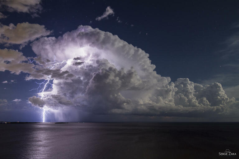 Serge Zaka with 'Lightning from an Isolated Storm over Cannes Bay'